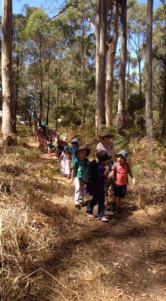 Photo of Spirit of Play students exploring the outdoors on their library walk