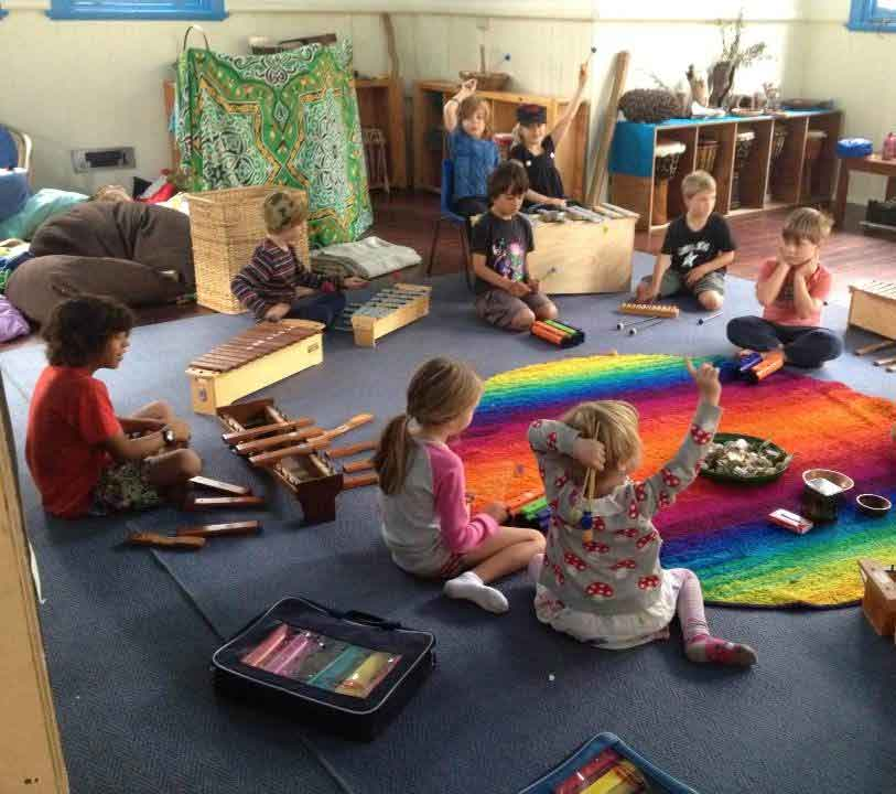 Spirit of play students sitting on the floor during music class