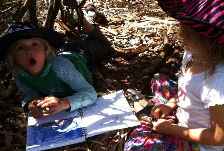 Photo of Spirit of Play students writing in their journals