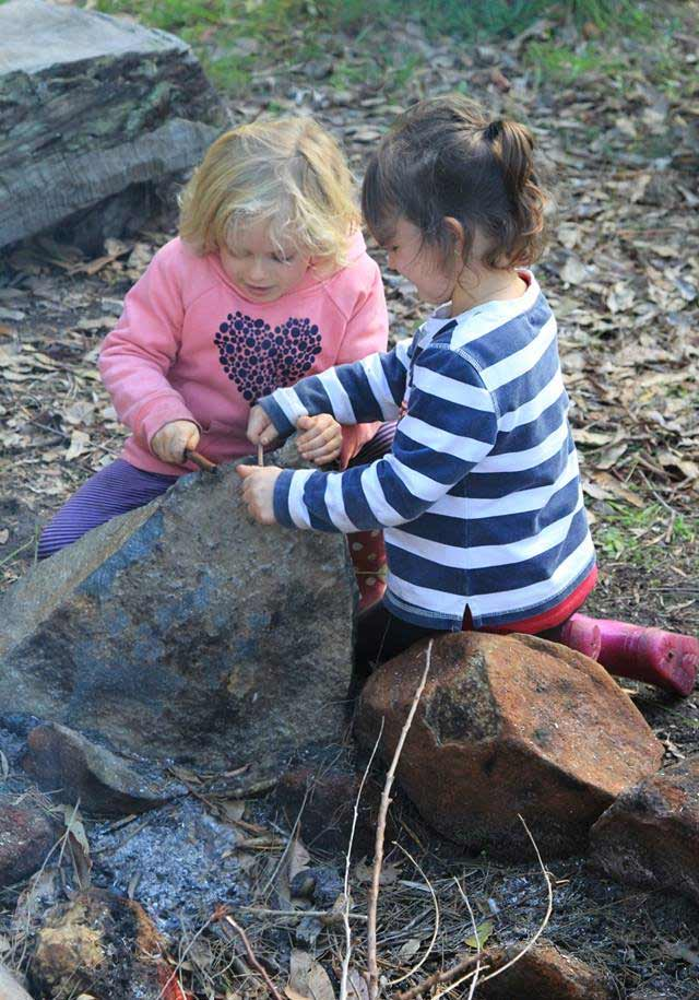 Photo of two Spirit of Play students playing together outside